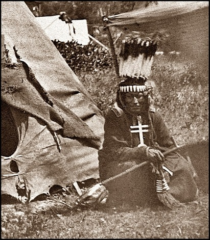 Little Big Mouth a medicine man seated in front of his lodge near Fort Sill Oklahoma. min